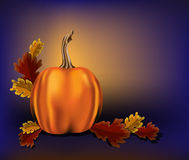 Pumpkin with oak leaves. Autumn leaves and pumpkin on a blue background Royalty Free Stock Image