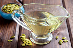 Pumpkin oil and seeds Royalty Free Stock Photo