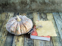 Pumpkin old paper and notebook on wooden Stock Photos
