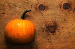 Pumpkin on old wooden table in rustic vintage style Royalty Free Stock Images
