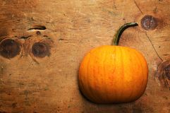 Pumpkin on old wooden table in rustic vintage style Royalty Free Stock Photography