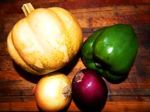 Pumpkin, onion golden, purple onion, green bell pepper Stock Photo