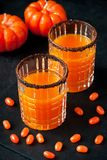 Pumpkin orange cocktail in glass mug. Fall Seasonal Drinks royalty free stock image
