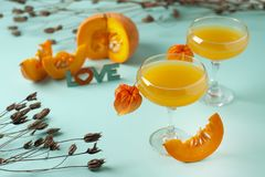 Pumpkin and orange spiced fall drink, halloween concept. Pumpkin and orange spiced fall drink, halloween concept royalty free stock photos
