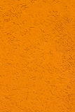 Pumpkin orange stucco wall   texture background. High res pumpkin orange stucco wall  texture background from small Italian village Royalty Free Stock Photo