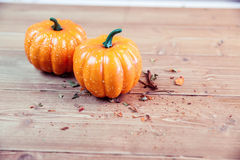 Pumpkin ornaments on desk Royalty Free Stock Photo