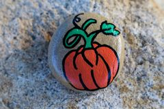 Pumpkin painted on a small rock Royalty Free Stock Photography