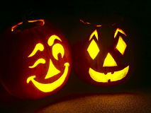 Pumpkin Pair. Two carved jack-o-lantern pumpkins side by side, one winking Stock Images