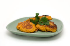 Pumpkin pancakes. On light green plate on white background Stock Photography