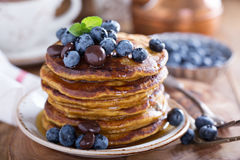 Pumpkin pancakes with blueberries Stock Photography