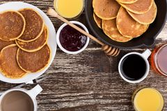 Pumpkin pancakes breakfast or brunch. Table viewed from above. Pumpkin pancakes breakfast or brunch. Homemade  pancakes with berry jam and honey, orange juice Stock Images
