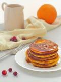 Pumpkin pancakes with caramel sause and cranberries. Fresh homemade flapjacks. Thanksgiving treat Royalty Free Stock Photos