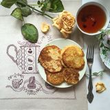 Pumpkin pancakes. Delicious breakfast: still life with pumpkin pancakes on embroidered linen napkin Royalty Free Stock Photos