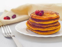 Pumpkin pancakes with fresh cranberries. Fresh homemade flapjacks. Thanksgiving treat. Horizontal Royalty Free Stock Images