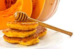 Pumpkin pancakes with honey Stock Photo