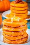Pumpkin pancakes with honey and butter Royalty Free Stock Photos