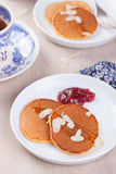 Pumpkin pancakes with honey, nuts and jam in a white plate on a table. Royalty Free Stock Photos
