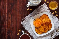 Pumpkin pancakes with honey and tea royalty free stock image