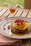Pumpkin pancakes with jelly and pomegranate Stock Images