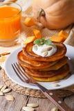 Pumpkin pancakes and juice closeup Stock Photos