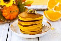 Pumpkin pancakes. With orange juice and cinnamon Royalty Free Stock Photos