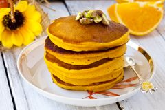 Pumpkin pancakes. With orange juice and cinnamon Stock Photography