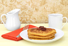 Pumpkin pancakes, pecans, and coffee. Royalty Free Stock Photo
