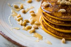 Pumpkin baked pancakes on a plate Royalty Free Stock Images