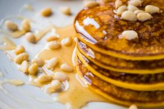 Pumpkin baked pancakes on a plate Stock Images