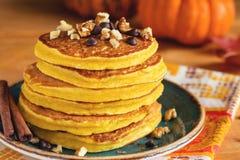 Pumpkin pancakes on plate Royalty Free Stock Image