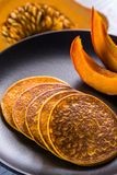 Pumpkin baked pancakes on a plate Royalty Free Stock Photos
