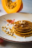 Pumpkin baked pancakes on a plate Stock Photography