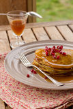 Pumpkin pancakes with quince jelly and pomegranate Royalty Free Stock Photography