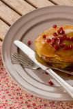 Pumpkin pancakes with quince jelly and pomegranate Royalty Free Stock Photos