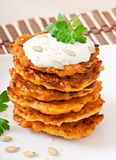 Pumpkin pancakes with sour cream. On plate Stock Photography