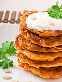 Pumpkin pancakes with sour cream. On plate Royalty Free Stock Photos