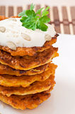 Pumpkin pancakes with sour cream. On plate Stock Image