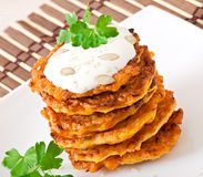 Pumpkin pancakes with sour cream. On plate Royalty Free Stock Photo
