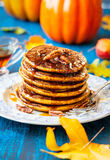 Pumpkin pancakes. Spiced Pumpkin pancakes with maple syrup and pecan Royalty Free Stock Photography