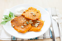Pumpkin pancakes on a white plate Stock Images