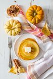 Pumpkin pancakes on white plate with butter and honey. White wood background Royalty Free Stock Image