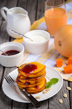 Pumpkin pancakes on white plate Royalty Free Stock Image