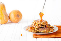 Pumpkin pancakes on white table Stock Photo