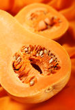 Pumpkin part on orange Royalty Free Stock Photography
