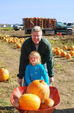 Pumpkin patch. Portrait of a father and doughtier at a pumpkin patch in autumn Stock Photos