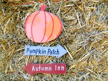 Pumpkin Patch. A hay bale with a sign signaling the way to the Pumpkin Patch Stock Photos