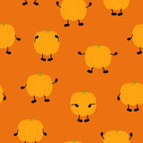 Pumpkin pattern. Seamless Halloween pattern with orange pumpkins with black hands and legs on orange background. Ideal for holiday decoration, wrapping paper Stock Image