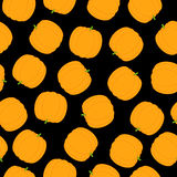 Pumpkin pattern. Seamless orange pumpkin Halloween pattern on dark black background. Ideal for holiday decoration, wrapping paper, wallpaper, gift boxes, other Royalty Free Stock Photos