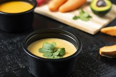 Pumpkin and pea soups with vegetables for salad, blurred background and selective focus, proper nutrition stock photos