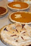Pumpkin, pecan, and berry pie at Thanksgiving stock photo